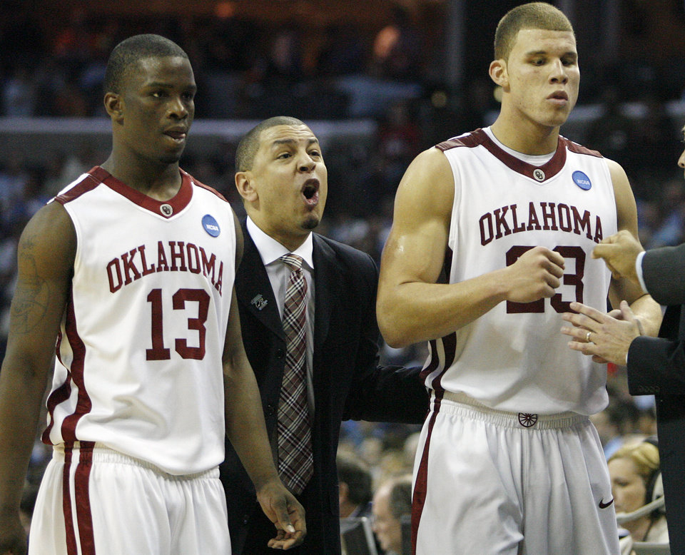 Oklahoma coach Jeff Capel reacts as Willie Warren and Blake Griffin come off the court at the end of the Sooners 84-71 win over Syracuse during the second half of the NCAA Men's Basketball Regional at the FedEx Forum on Friday, March 27, 2009, in Memphis, Tenn.