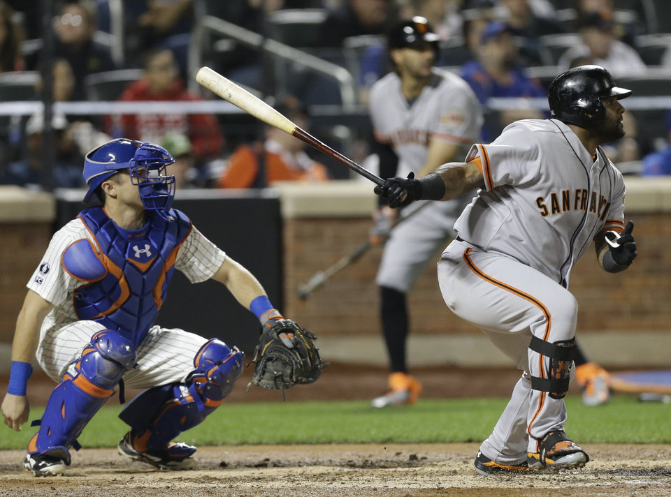Photo - San Francisco Giants' Pablo Sandoval follows through on a double during the seventh inning of a baseball game against the New York Mets on Saturday, Aug. 2, 2014, in New York. (AP Photo/Frank Franklin II)