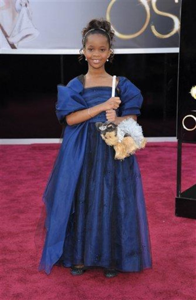 Photo - Actress Quvenzhane Wallis arrives at the 85th Academy Awards at the Dolby Theatre on Sunday Feb. 24, 2013, in Los Angeles. (Photo by John Shearer/Invision/AP)