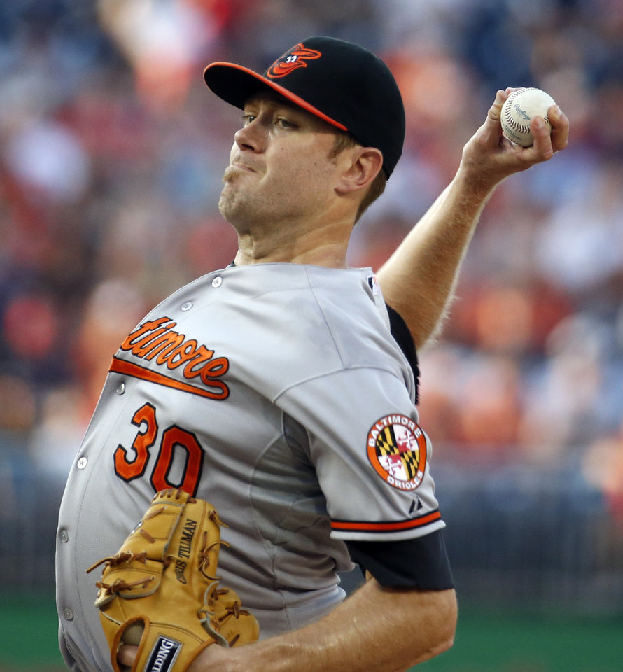 Photo - Baltimore Orioles starting pitcher Chris Tillman throws during the first inning of an interleague baseball game against the Washington Nationals at Nationals Park, Monday, July 7, 2014, in Washington. (AP Photo/Alex Brandon)