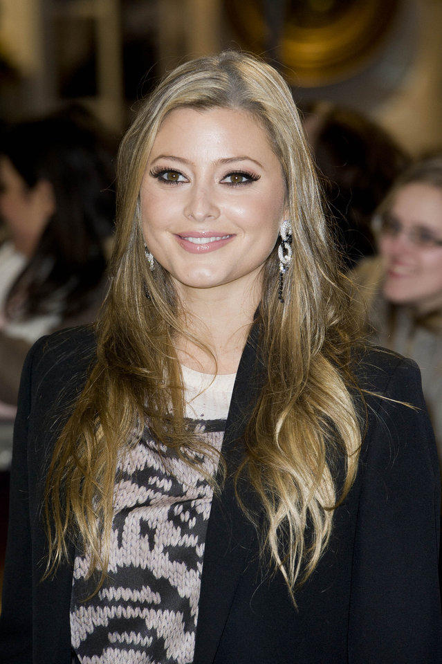 Australian actress Holly Valance arrives for the UK premiere of 'Twilight Breaking Dawn Part 1' at a central London venue,  Wednesday, Nov. 16, 2011. (AP Photo/Jonathan Short) ORG XMIT: LJS117