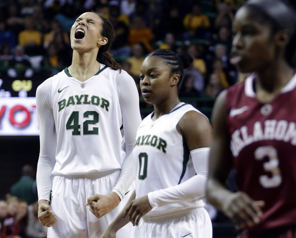 Baylor's Brittney Griner (42) reacts after breaking the NCAA women's career record for blocks against Oklahoma during the second half of an NCAA college basketball game Saturday, Jan. 26, 2013, in Waco Texas.  Also show are Baylor's Odyssey Sims (0) and Oklahoma's Aaryn Ellenberg (3).  (AP Photo/LM Otero) ORG XMIT: TXMO107