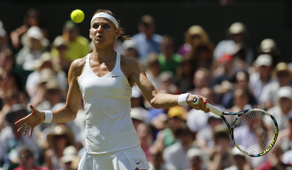 Photo - Lucie Safarova of Czech Republic plays a return to Petra Kvitova of Czech Republic during their women's singles semifinal match at the All England Lawn Tennis Championships in Wimbledon, London, Thursday, July 3, 2014. (AP Photo/Ben Curtis)