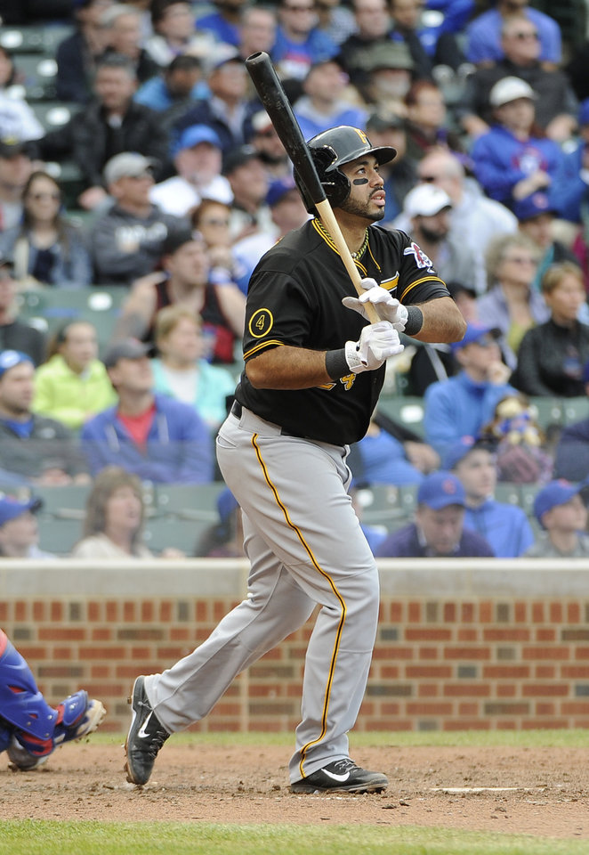 Photo - Pittsburgh Pirates' Pedro Alvarez watches his  three-run home run against the Chicago Cubs during the seventh inning of a baseball game on Thursday, April 10, 2014, in Chicago. (AP Photo/David Banks)