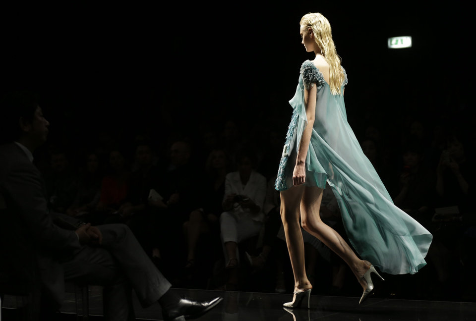 Photo -   A model wears a creation part of the Alberta Ferretti women's Spring-Summer 2013 collection that was presented in Milan, Italy, Wednesday, Sept. 19, 2012. (AP Photo/Luca Bruno)