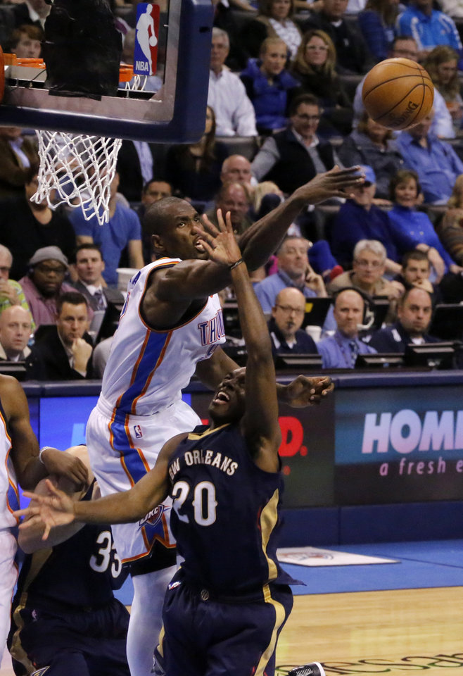 Photo - Oklahoma City's Serge Ibaka (9) blocks the shot of New Orleans' Quincy Pondexter (20) during an NBA game between the Oklahoma City Thunder and the New Orleans Pelicans at Chesapeake Energy Arena on Friday, Feb. 6, 2015. Photo by Bryan Terry, The Oklahoman