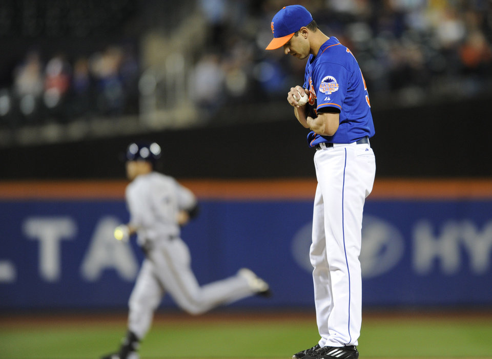 Photo - New York Mets pitcher Carlos Torres, right, reacts as Milwaukee Brewers' Norichika Aoki rounds the bases with a home run during the first inning of a baseball game Friday, Sept. 27, 2013, in New York. (AP Photo/Bill Kostroun)