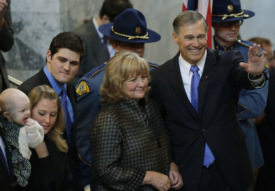 Gov. Jay Inslee, right, stands with his wife Trudi and other family members after he was sworn in as Washington state Governor, Wednesday, Jan. 16, 2013, in Olympia, Wash. (AP Photo/Ted S. Warren)