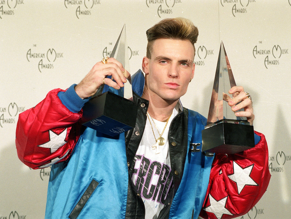 Photo - **FILE** Vanilla Ice displays his awards he won in the rock and rap catagories at the American Music Awards in this Jan. 28, 1991 file photo. The 36-year-old rap performer, who had a '90s hit with