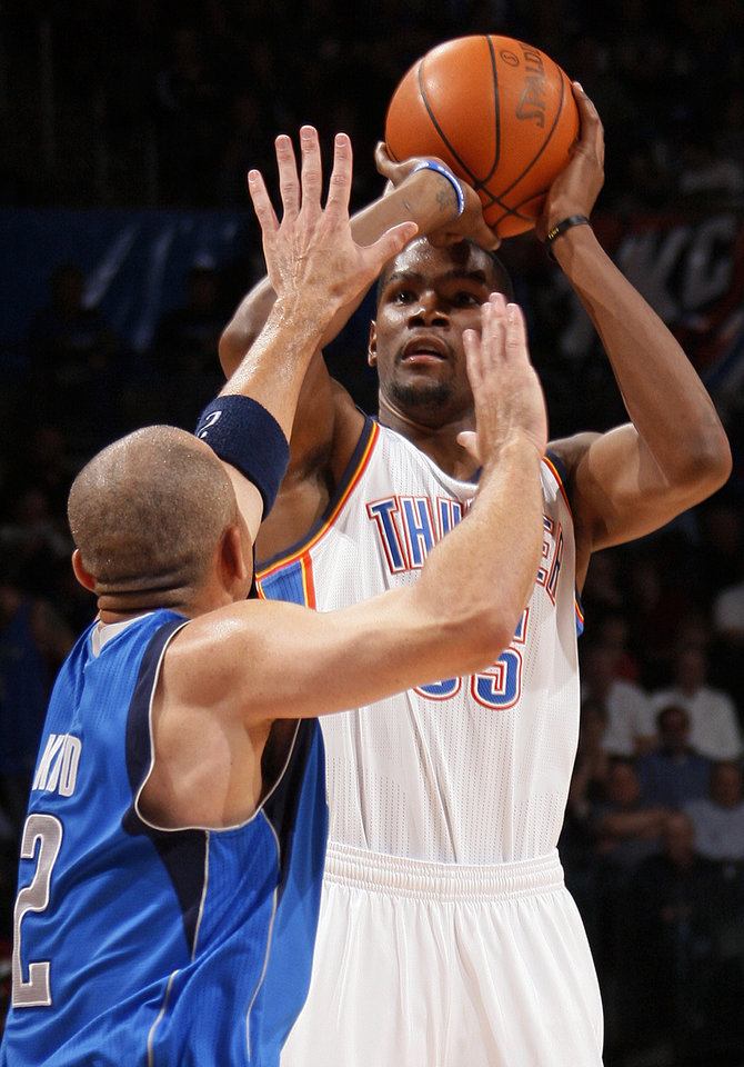 Oklahoma City's Kevin Durant (35) shoots against Dallas' Jason Kidd (2) during the NBA basketball game between the Oklahoma City Thunder and the Dallas Mavericks at Chesapeake Energy Arena in Oklahoma City, Monday, March 5, 2012. Photo by Nate Billings, The Oklahoman