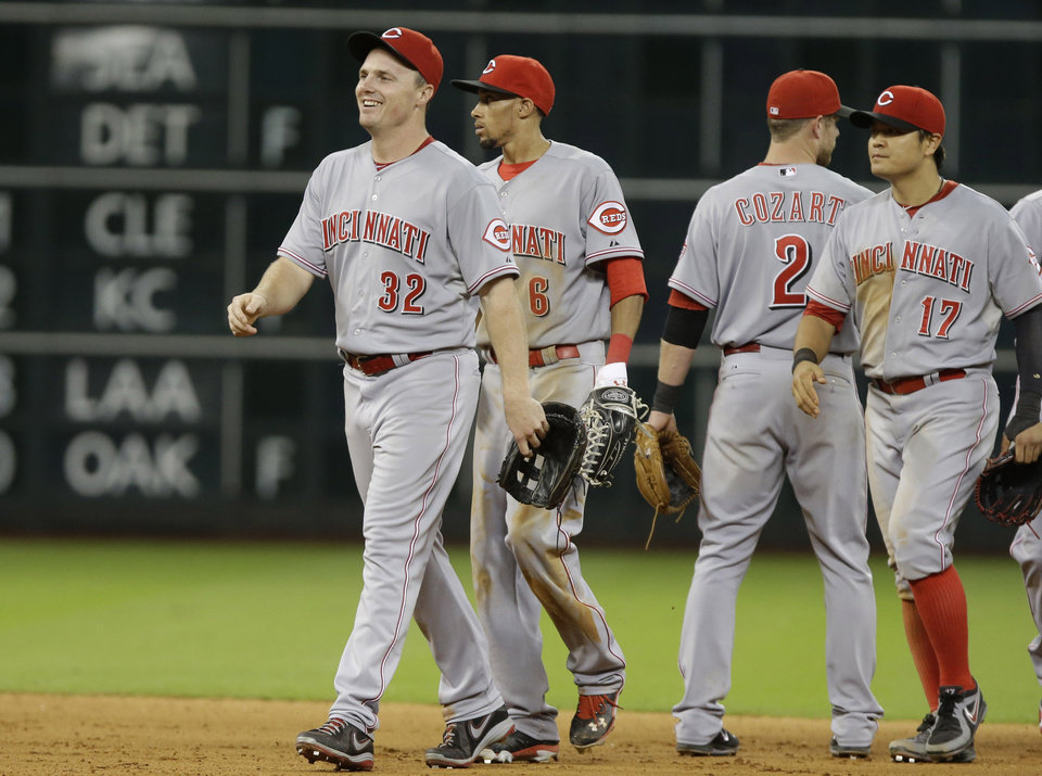 Photo - Cincinnati Reds' Jay Bruce (32) leads Billy Hamilton (6), Zack Cozart (2) and Shin-Soo Choo (17) off the field after the Reds beat the Houston Astros in 13 innings of a baseball game Wednesday, Sept. 18, 2013, in Houston. (AP Photo/Pat Sullivan)
