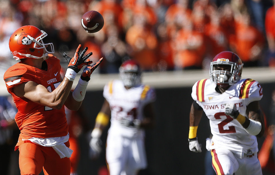 Photo - Oklahoma State's Charlie Moore (17) catches a touchdown pass as Iowa State's Jansen Watson (2) chases him during a college football game between Oklahoma State University (OSU) and Iowa State University (ISU) at Boone Pickens Stadium in Stillwater, Okla., Saturday, Oct. 20, 2012. Photo by Sarah Phipps, The Oklahoman