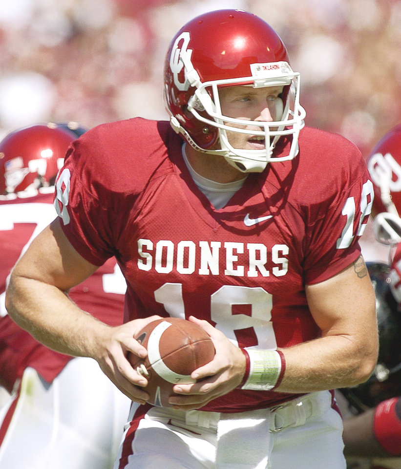 Former OU quarterback Jason White, left, knows what Heisman winner Sam Bradford, right, is going through. Photos by The Oklahoman Archive