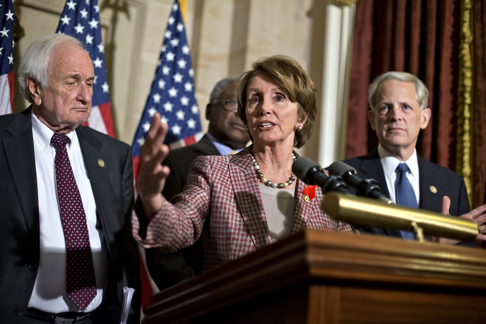 House Minority Leader Nancy Pelosi, D-Calif., flanked by Rep. Sander Levin, D-Mich., left, and Rep. Steve Israel, D-NY, right, speaks to reporters just after meeting with Treasury Secretary Timothy Geithner on the fiscal cliff negotiations, at the Capitol in Washington, Thursday, Nov. 29, 2012. The �fiscal cliff� is a combination of tax increases and spending cuts worth about $670 billion that will take effect at the start of next year unless Congress and the White House agree to postpone or replace them. (AP Photo/J. Scott Applewhite)