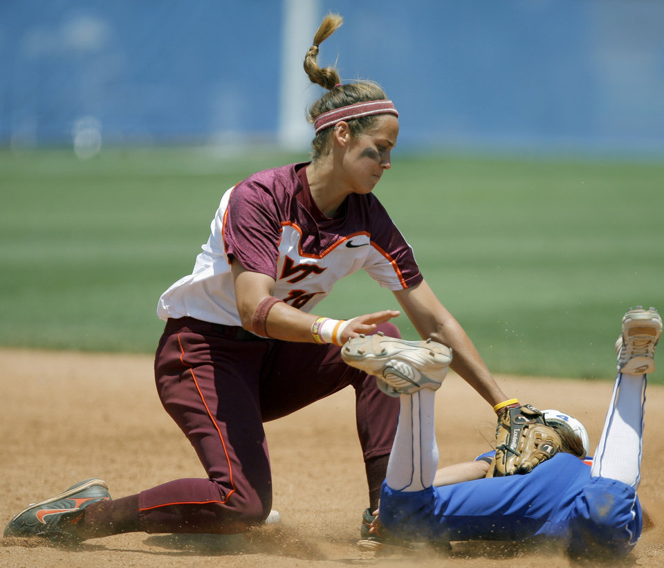 Photo - Virginia Tech's Misty Hall tags out Danyell Hines of Florida at second base in the seventh inning of  the Women's College World Series game between Florida and Virginia Tech at ASA Hall of Fame Stadium in Oklahoma City, Saturday, May 31, 2008. BY BRYAN TERRY, THE OKLAHOMAN