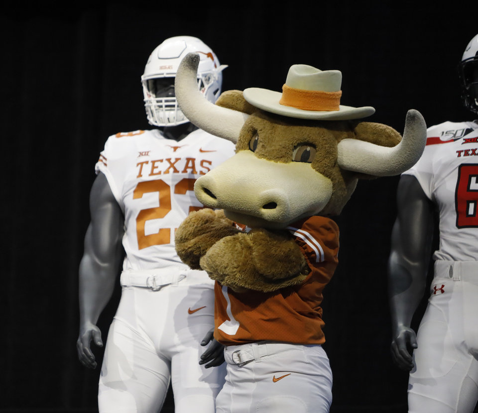 Photo - Texas mascot Hook'em poses on stage with team uniforms on the first day of Big 12 Conference NCAA college football media days Monday, July 15, 2019, at AT&T Stadium in Arlington, Texas. (AP Photo/David Kent)