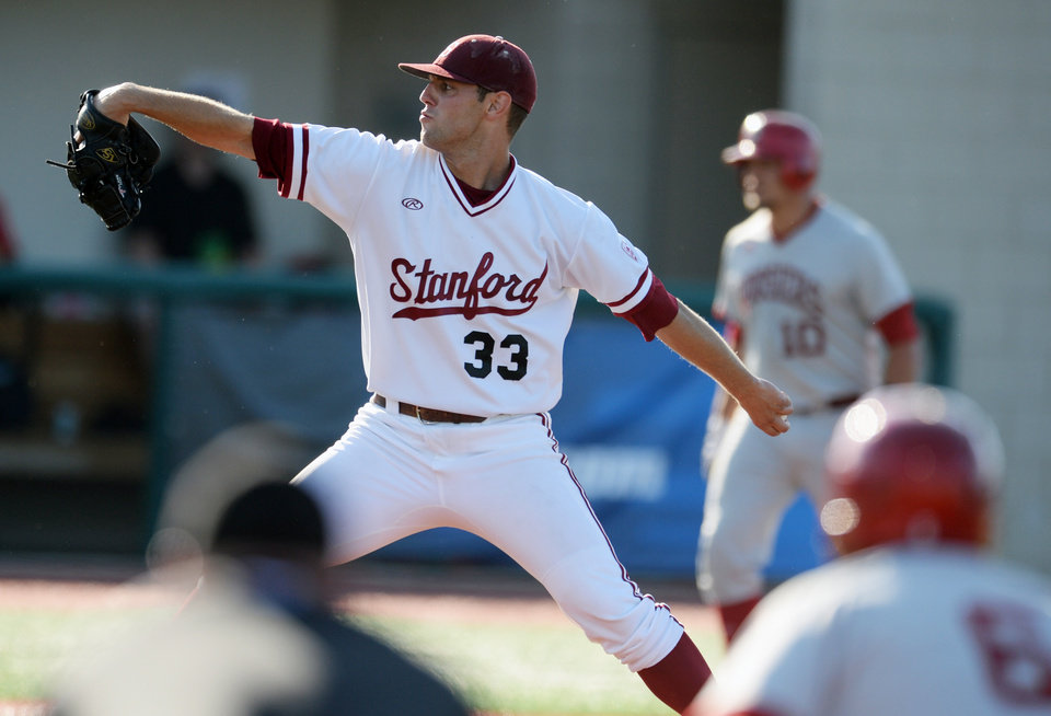 Photo - Stanford pitcher John Hochstatter (33) throws against Indiana during an NCAA college baseball regional game in Bloomington, Ind., Saturday, May 31, 2014. (AP Photo/The Herald Times, Chris Howell)