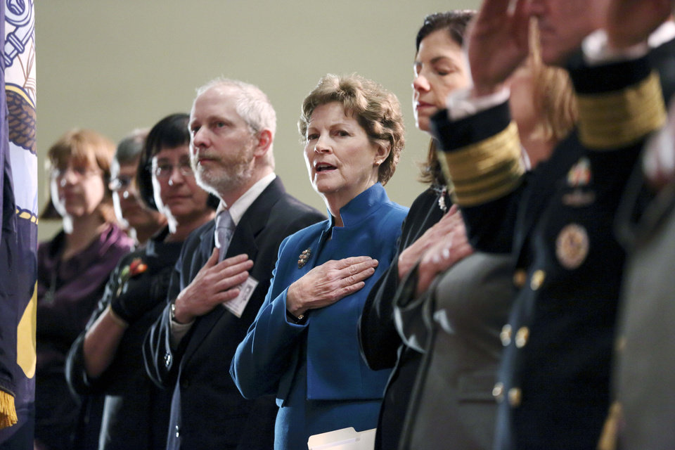 Photo - Sen. Jeanne Shaheen (D-N.H.), center, stands with other officials during a service marking the 50th anniversary of the sinking of the USS Thresher, Saturday, April 6, 2013, at the high school in Portsmouth, N.H. (AP Photo/Michael Dwyer)