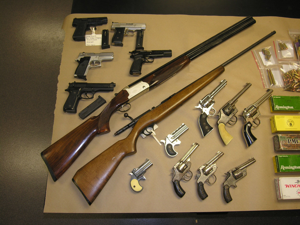 Photo - Guns and ammunition were among items seized Wednesday by the Oklahoma County Sheriff's office at a home in Harrah. Photo provided