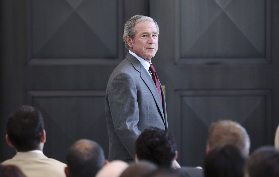 Photo - File - In this July 10, 2013 file photo, former President George W. Bush walks off the stage after giving a speech before a U.S. citizen swearing in ceremony at the The George W. Bush Presidential Center in Dallas.  Bush has successfully undergone a heart procedure after doctors discovered a blockage in an artery. Bush spokesman Freddy Ford says a stent was inserted during a procedure Tuesday, Aug 6, 2013 at Texas Health Presbyterian Hospital in Dallas. (AP Photo/LM Otero, File)