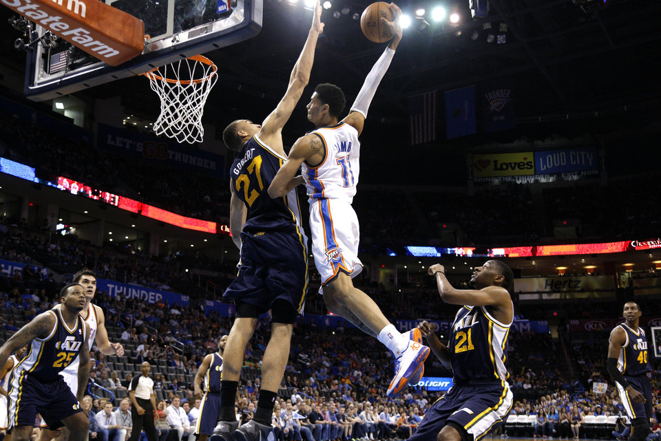 Oklahoma City 's Jeremy Lamb (11) attempts a dunk as Utah's Rudy Gobert (27) defends during the NBA game between the Oklahoma City Thunder and the Utah Jazz at the Chesapeake Energy Arena, Sunday, March 30, 2014, in Oklahoma City. Photo by Sarah Phipps, The Oklahoman