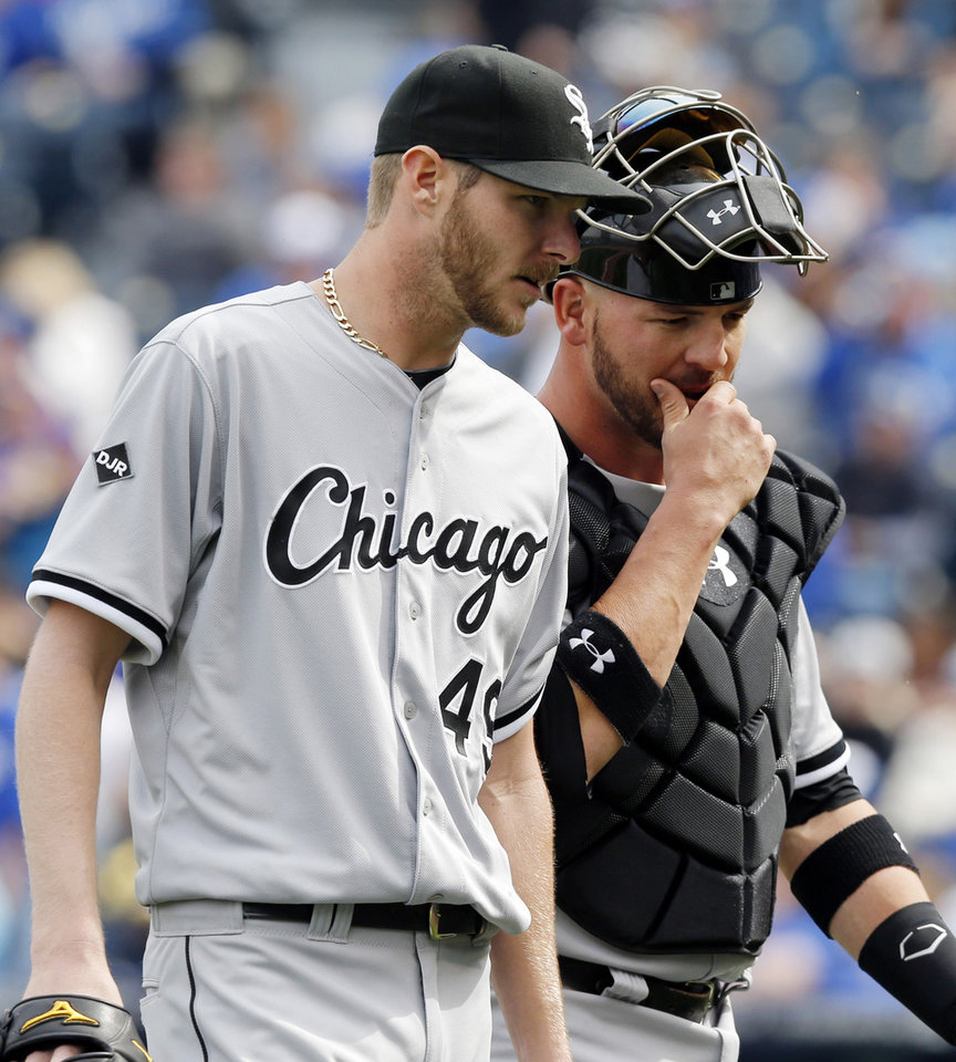 Photo - Chicago White Sox starting pitcher Chris Sale talks with Chicago White Sox catcher Tyler Flowers, right, while walking to the dugout following the seventh inning of a baseball game against the Kansas City Royals at Kauffman Stadium in Kansas City, Mo., Sunday, April 6, 2014. The White Sox won 5-1. (AP Photo/Orlin Wagner)