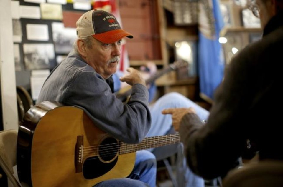 Photo -  Joe Baxter with the Round Barn Ramblers talks in March with T.Z. Wright during a Morning Music Session inside the Arcadia Round Barn. [Bryan Terry/The Oklahoman Archives]