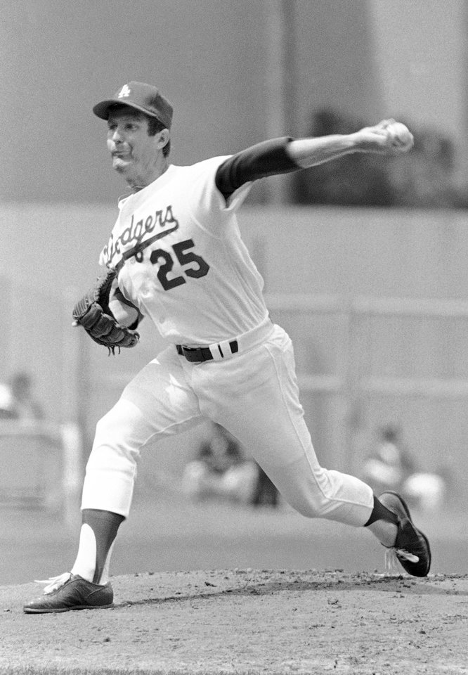 Photo - FILE - In this April 14, 1978, file photo, Los Angeles Dodgers left-hander Tommy John delivers a pitch against Atlanta Braves during an opening day baseball game in Dodgers Stadium, Los Angeles. UCL has increased 10-fold in the first decade of the 21st century, Dr. James Andrews, one of the world's top orthopedic doctors, and and Dr., Jeremy Bruce wrote in the May issue of the Journal of the American Academy of Orthopaedic Surgeons, citing a paper published by J.R. Dugas in 2010. Dr. Andrews will be meeting with a research committee on Monday at Major League Baseball's headquarters.  (AP Photo/LM, File)