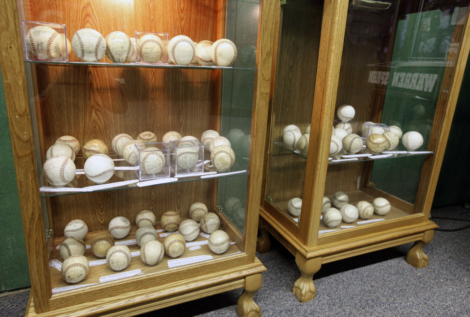 Photo - BASEBALL COLLECTION: This collection of autographed baseballs is on display at the Oklahoma Sports Hall of Fame in Guthrie, OK, Thursday, April 11, 2013,  By Paul Hellstern, The Oklahoman