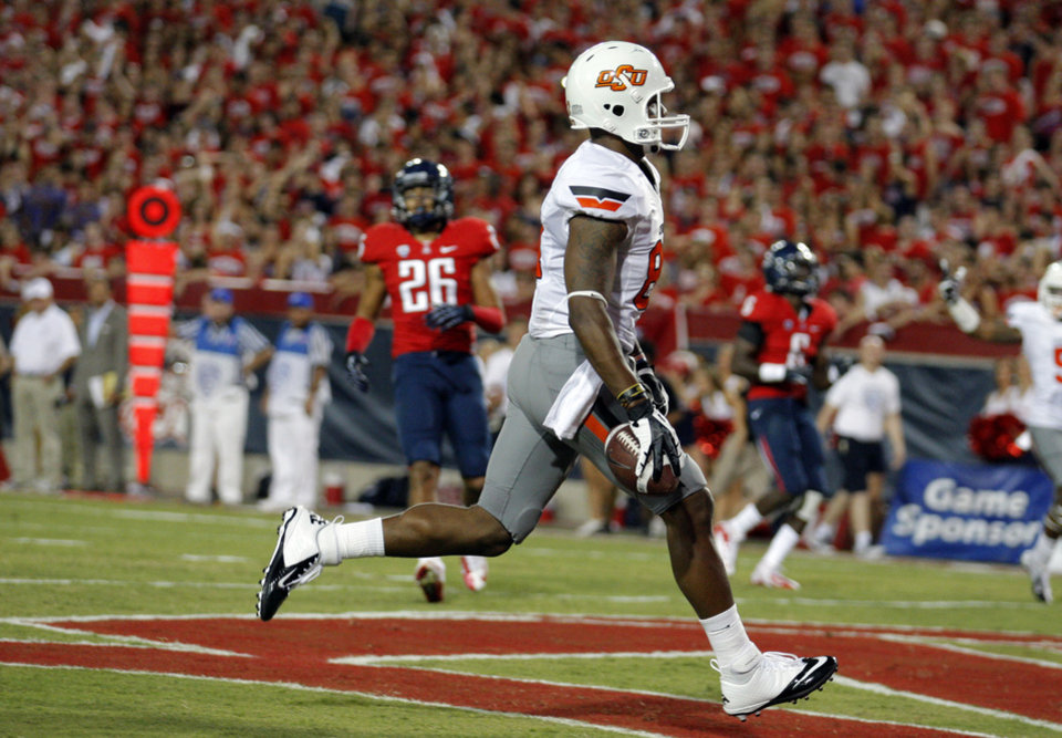 Photo - Oklahoma State's Tracy Moore (87) scores a touchdown in the first quarter of the college football game between the University  of Arizona and Oklahoma State University at Arizona Stadium in Tucson, Ariz.,  Saturday, Sept. 8, 2012. Photo by Sarah Phipps, The Oklahoman