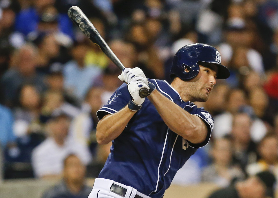 Photo - San Diego Padres' Seth Smith collects his second hit of the game with a line drive single to right that would lead to a run against the Washington Nationals during the fourth inning of a baseball, game Saturday, June 7, 2014, in San Diego. (AP Photo/Lenny Ignelzi)