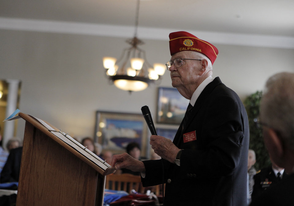 Calvin C. Turpin, former national chaplain of The American Legion, speaks during a Veterans Day ceremony at Edmond Mansions.