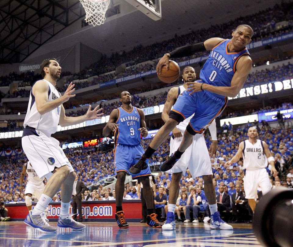 Oklahoma City's Russell Westbrook (0) leaps for the ball beside Peja Stojakovic (16) of Dallas during game 5 of the Western Conference Finals in the NBA basketball playoffs between the Dallas Mavericks and the Oklahoma City Thunder at American Airlines Center in Dallas, Wednesday, May 25, 2011. Photo by Bryan Terry, The Oklahoman