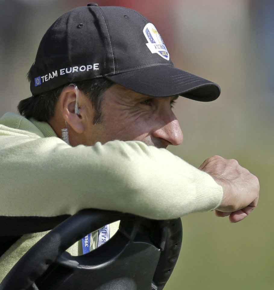 Photo -   European team captain Jose Maria Olazabal watches from the 10th fairway during a four-ball match at the Ryder Cup PGA golf tournament Friday, Sept. 28, 2012, at the Medinah Country Club in Medinah, Ill. (AP Photo/David J. Phillip)
