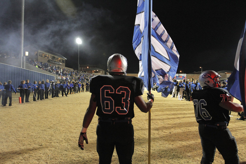 Photo - Guthrie's Zack Brown (63) and Malachai Galbraith (76) get read for a high school football game between Guthrie and East Central at The Rock in Guthrie, Friday, Nov. 18, 2011.  Photo by Garett Fisbeck, The Oklahoman
