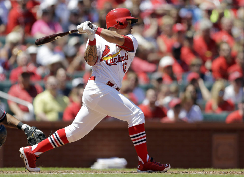 Photo - St. Louis Cardinals' Kolten Wong watches his three-run double during the second inning of a baseball game against the Atlanta Braves Sunday, May 18, 2014, in St. Louis. (AP Photo/Jeff Roberson)