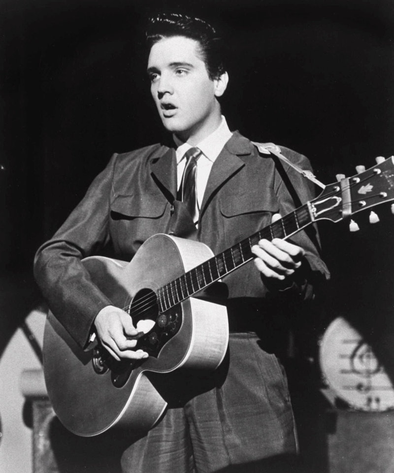 Elvis Presley performs in this 1956, file photo. (AP Photo)