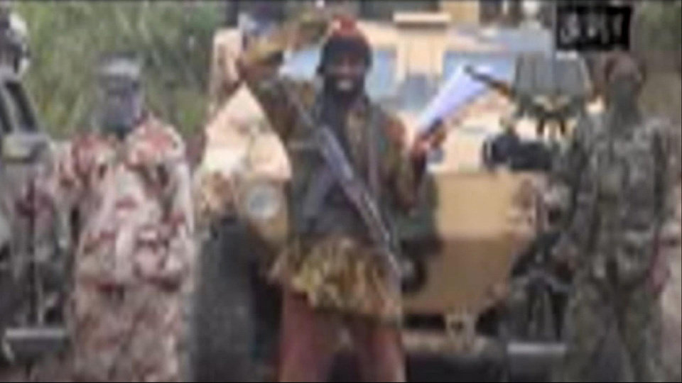 Photo - FILE - In this file image made from video received by The Associated Press on Monday, May 5, 2014, Abubakar Shekau, the leader of Nigeria's Islamic extremist group Boko Haram, speaks in a video in which his group claimed responsibility for the April 15 mass abduction of nearly 300 teenage schoolgirls in northeast Nigeria. Even before the kidnapping, the U.S. government was offering up to a $7 million reward for information leading to the arrest of Shekau, whom the U.S. has labeled a specially designated global terrorist. (AP Photo/File)