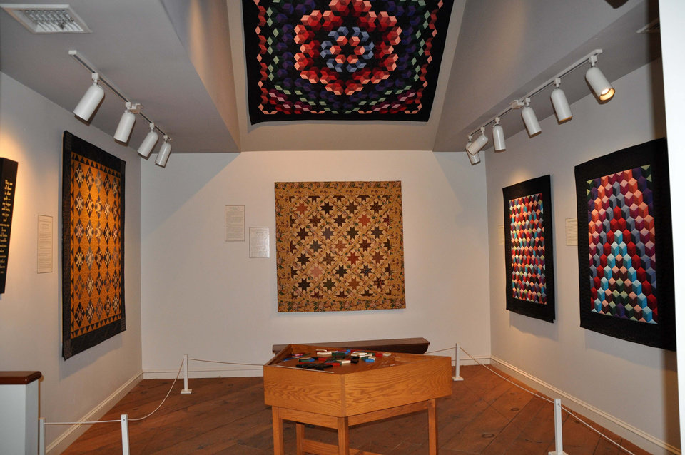 """This 2012 photo released by The Quilt Museum at The Old Country Store shows quilts displayed as part of the """"Favorite Reproduction Quilts by Jo Morton,"""" at The Quilt Museum at The Old Country Store in Intercourse, Pa. The harvest season is nearing its glorious end, and the culture, architecture and history of Pennsylvania's Amish country can be seen for free in Lancaster County, where many Amish settled, starting in the early 1700s. (AP Photo/The Quilt Museum at The Old Country Store)"""