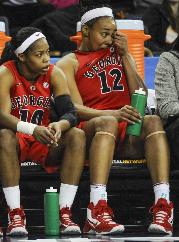 Georgia forward Jasmine Hassell (12) and guard Jasmine James (10) wait out the end against Kentucky during the second half of an NCAA college basketball game in the Southeastern Conference tournament on Saturday, March 9, 2013, in Duluth, Ga. Kentucky won 60-38. (AP Photo/John Amis)