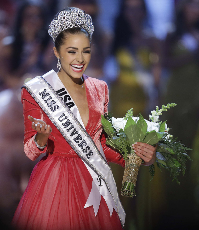 Photo - Miss USA, Olivia Culpo, waves to the crowd after being crowned Miss Universe during the Miss Universe competition, Wednesday, Dec. 19, 2012, in Las Vegas. (AP Photo/Julie Jacobson)