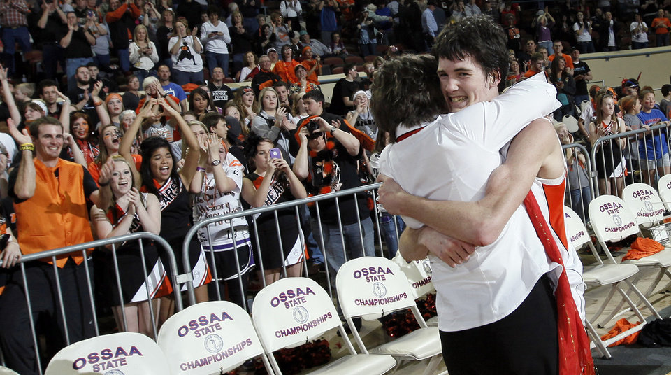 Photo - Cheyenne-Reydon's Austin Thrash (12) hugs his mother, Traci Thrash, after the Class A boys state championship high school basketball game between Cheyenne-Reydon and Merritt at State Fair Arena in Oklahoma City, Saturday, March 3, 2012. Cheyenne-Reydon won, 51-30. Photo by Nate Billings, The Oklahoman