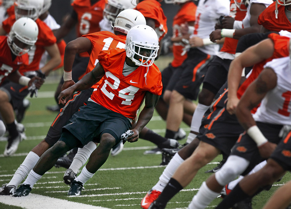 Photo - Oklahoma State speedster Tyreek Hill (24) runs during the first team practice of the fall at the Sherman E. Smith Training Facility on the campus of Oklahoma State University in Stillwater on August 1, 2014. Photo by KT King, The Oklahoman