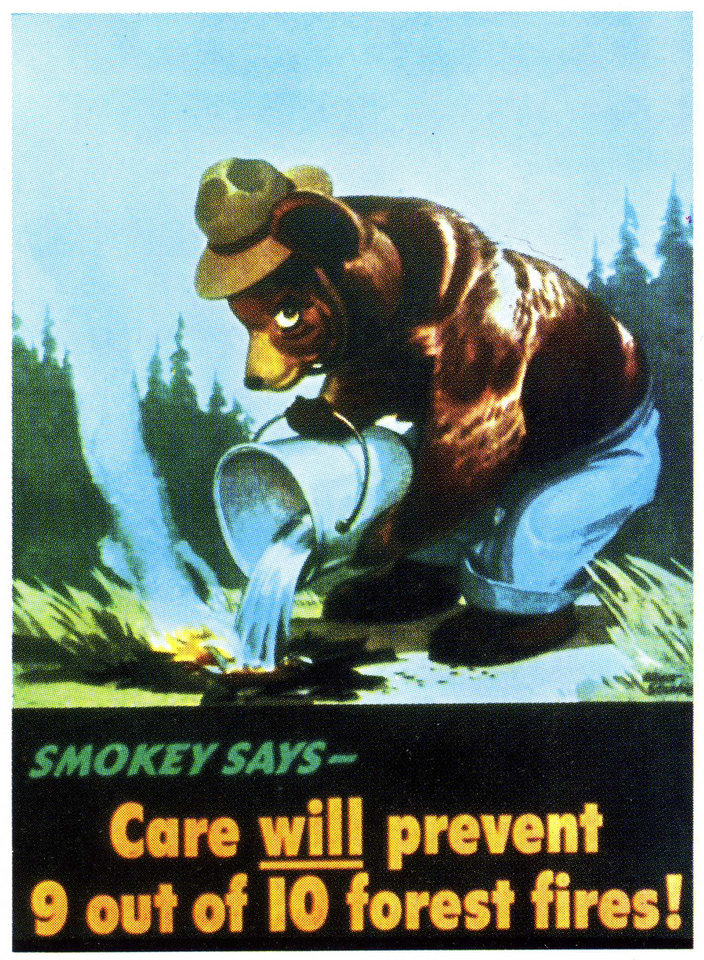 Photo - This image provided by the Ad Council  circa 1945 shows an early version of the Smokey Bear campaign.  Smokey Bear was created in 1944 because of fears that enemy shelling from Japan would cause forest fires while most U.S. firefighters were in battle overseas. When the war ended, Smokey stuck around _ and he is now at the center of the longest-running public service announcement campaign in U.S. history. Research shows he is known by 96 percent of American adults and ranks near Mickey Mouse and Santa Claus for name recognition. Smokey turns          seventy on Saturday Aug. 9, 2014. (AP Photo/Ad Council)