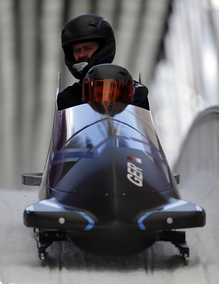 Photo - The GER-1 sled from Germany brakes in the finish area after completing a training run for the men's two-man bobsled at the 2014 Winter Olympics, Wednesday, Feb. 5, 2014, in Krasnaya Polyana, Russia. (AP Photo/Michael Sohn)