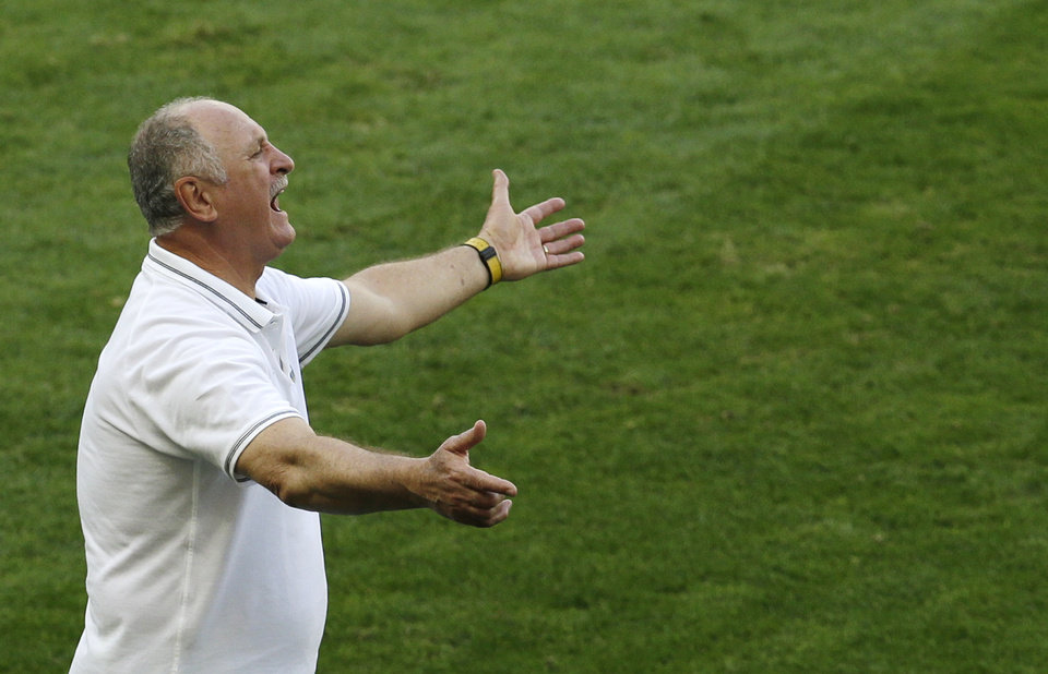 Photo - Brazil's coach Luiz Felipe Scolari instructs his players during the World Cup round of 16 soccer match between Brazil and Chile at the Mineirao Stadium in Belo Horizonte, Brazil, Saturday, June 28, 2014. (AP Photo/Hassan Ammar)