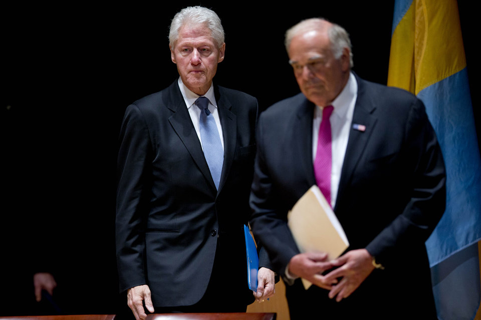 Photo - Former President Bill Clinton, left, and former Pennsylvania Gov. Ed Rendell arrives for a public memorial service for Philadelphia Inquirer co-owner Lewis Katz Wednesday, June 4, 2014, at Temple University in Philadelphia. Katz and six others died when his private jet crashed during takeoff on Saturday, May 31, 2014 in Massachusetts. He was 72.  (AP Photo/Matt Rourke)