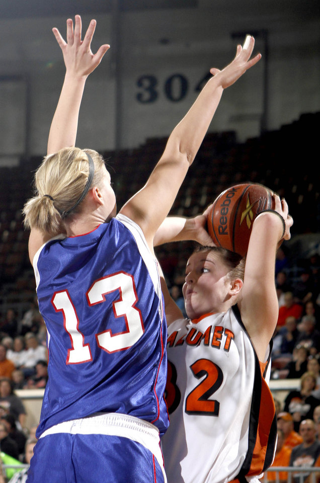 Photo - Calumet's Megan Snyder looks to the pass the ball as Chelsea DeVaughan defends during the girls Class A high school playoff game between Calumet and Ft. Cobb-Broxton, Thursday, March 4, 2010, at the State Fair Arena in Oklahoma City. Photo by Sarah Phipps, The Oklahoman