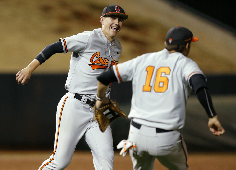 OSU\'s Vraig McConaughy, left, and Tanner Krietemeier celebrate after winning the Bedlam baseball game between the University of Oklahoma and Oklahoma State University at L. Dale Mitchell Park in Norman, Okla., Tuesday, April 1, 2014. Oklahoma State won 3-1. Photo by Bryan Terry, The Oklahoman