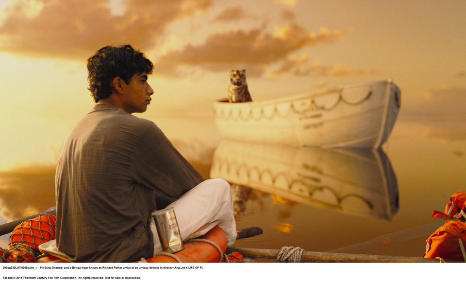 "Pi (Suraj Sharma) is cast away with a ferocious Bengal tiger in ""Life of Pi."" TWENTIETH CENTURY FOX PHOTO"